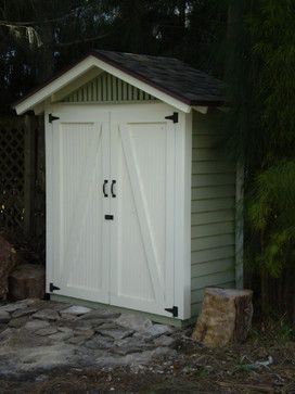 Small outdoor storage shed perfect for along the fence or the side of the house.