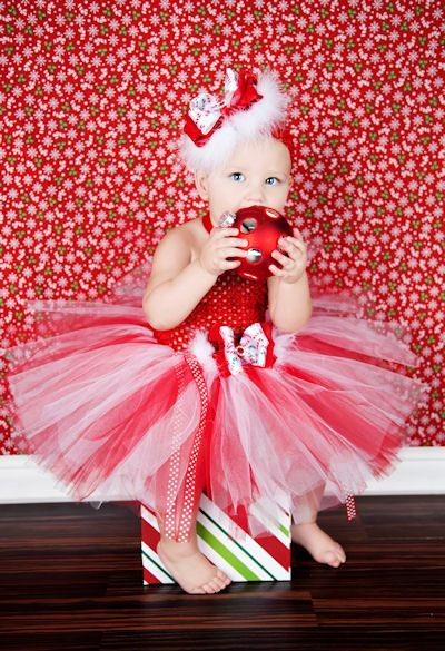 tape wrapping paper to wall for backdrop!  perfect christmas pictures.
