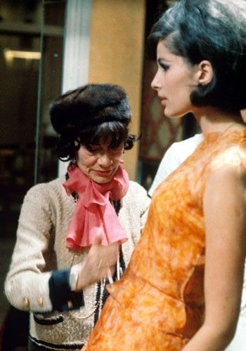 Coco dressing a model in the 1960s.
