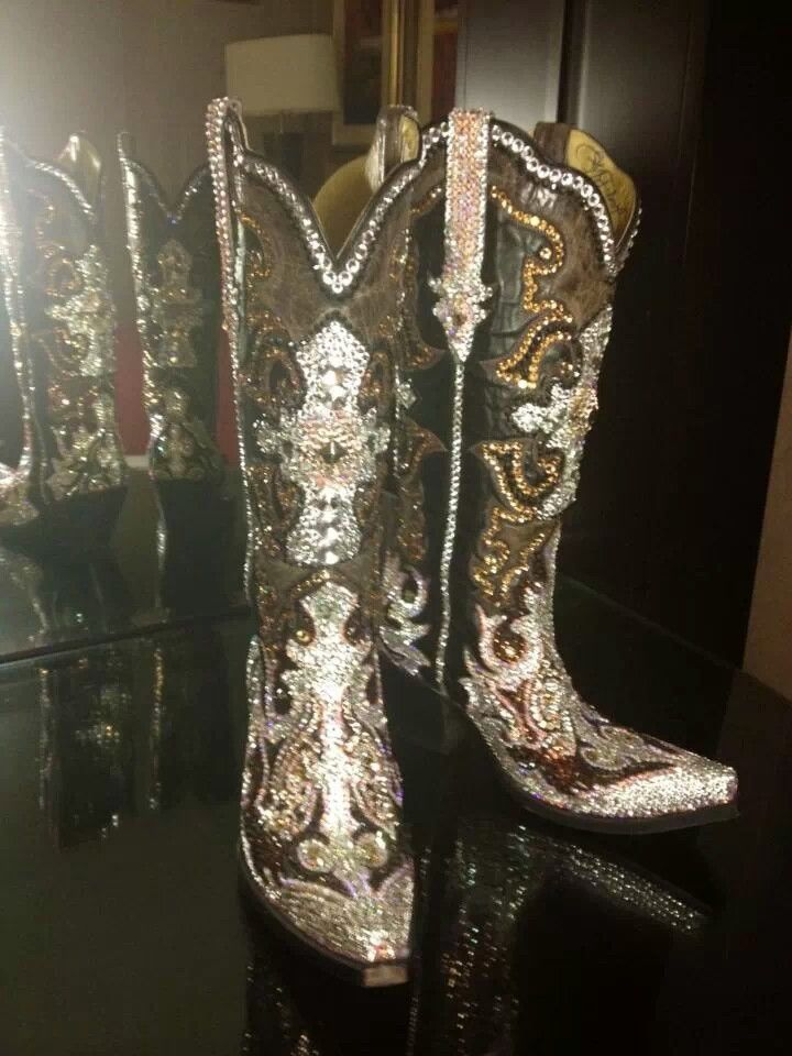 Yowzer! Badda Bling! Paradise swarovski crystal bling cowgirl boots. Talk about pricey wedding shoes :)