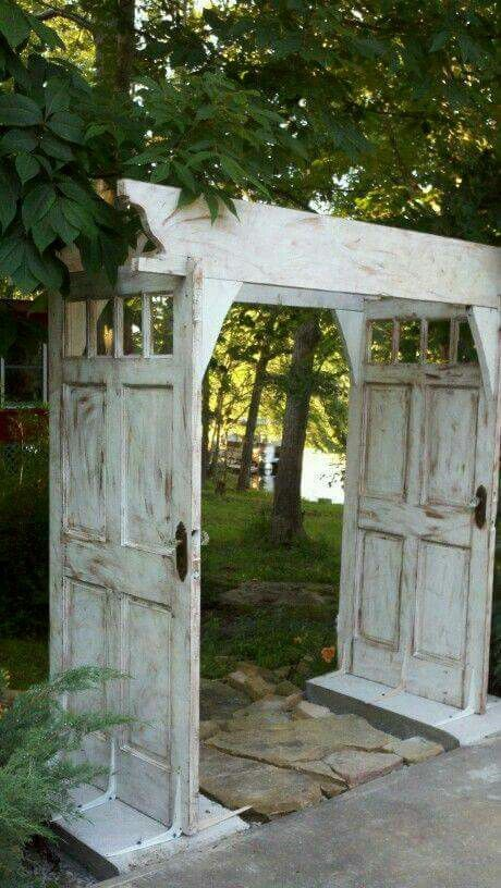 repurposed door arbour or gate into garden - so pretty!