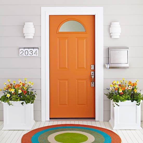 Accent colors would enliven entry way to maximize curb appeal. I like the idea of an oversized doormat or small outdoor rug. Didn't know that PVC planters are paintable.
