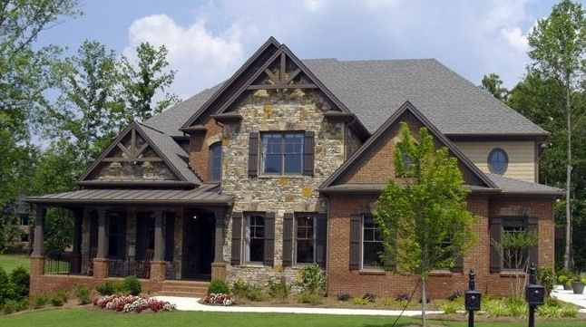 A modified Craftsman style home with a brick veneer and natural stone accents...an idea!