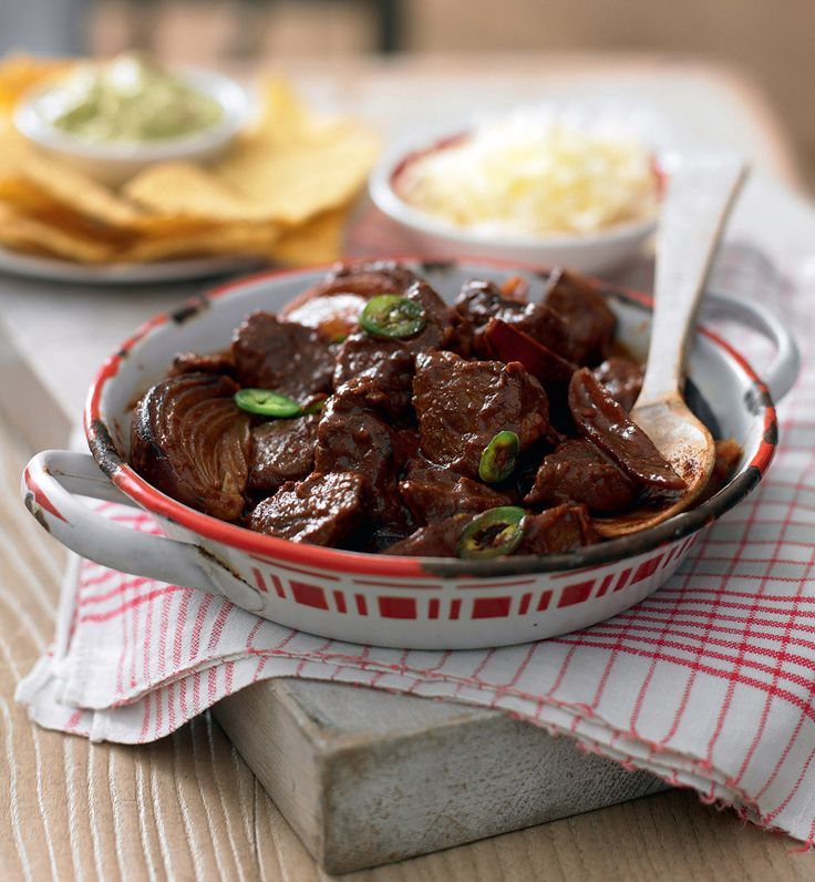 This recipe cooks steak with red onions, cumin, sweet paprika and cocoa powder until it's tender and sticky. A perfect midweek meal recipe when served with nachos, guacamole and soured cream.