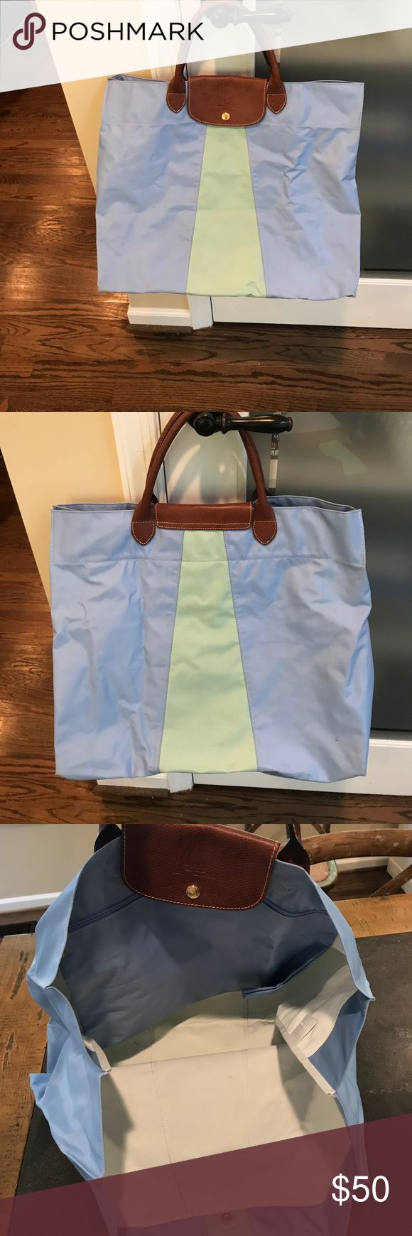 "Long champ Pliage Tote!! 👜 Great ""throw-all in"" tote perfect for work, school or being a mom!! Gently used and has a few marks on the interior. Has a big inside zip compartment! 15"" tall, 19"" wide, 11"" base. This bag is a must!!! Longchamp Bags Totes"