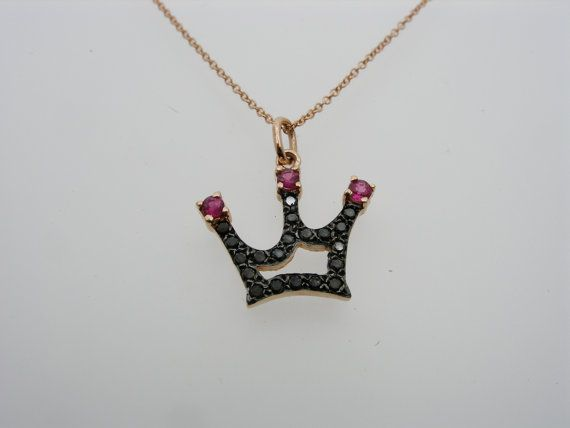 This unique crown is made of sterling silver and is set with cubic zircon by hand.Its assymetrical shape make this crown distinguish and simple at the same time. Ideal for every day use. Its dimensions are 0.70×0.70inches aproxx.and it hangs on a 16 inches sterling silver chain.