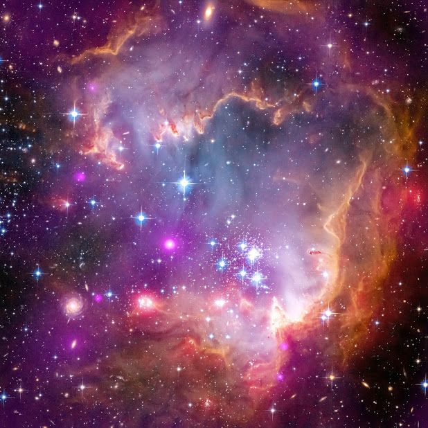 """Hubble/Chandra/Spitzer composite image of NGC 602, in the """"wing"""" of the Small Magellanic Cloud"""
