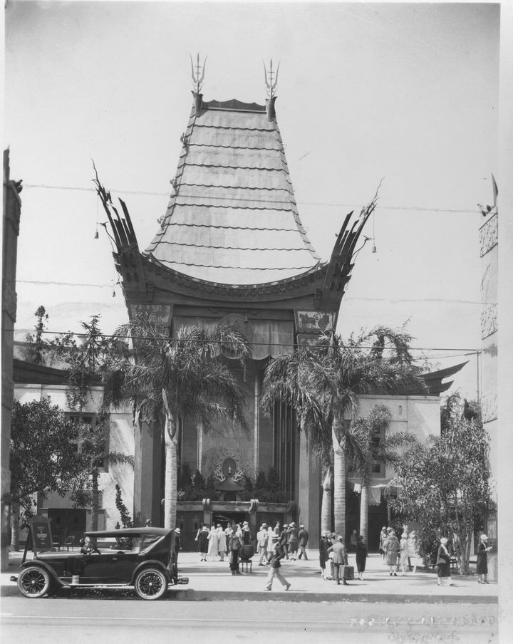 Watch a movie at Grauman's Chinese Theater in Los Angeles (1929 photo) Look at the car out front