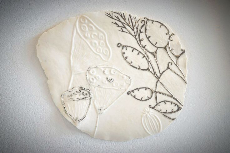 Handmade wall panel/plate made in recycled porcelain paperclay with embossing printing patterns, black slip and platinum.