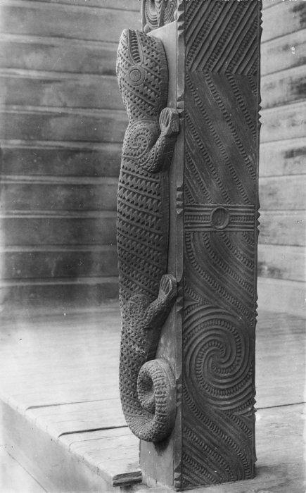 Wooden carved lizard on a Maori meeting house post at Whakarewarewa
