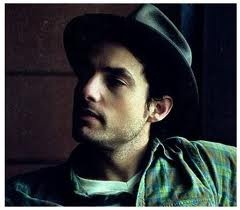 """Jakob Dylan """"Dressed in thunder a cloud came 'round. In the shape of a lion, a hand came down."""""""