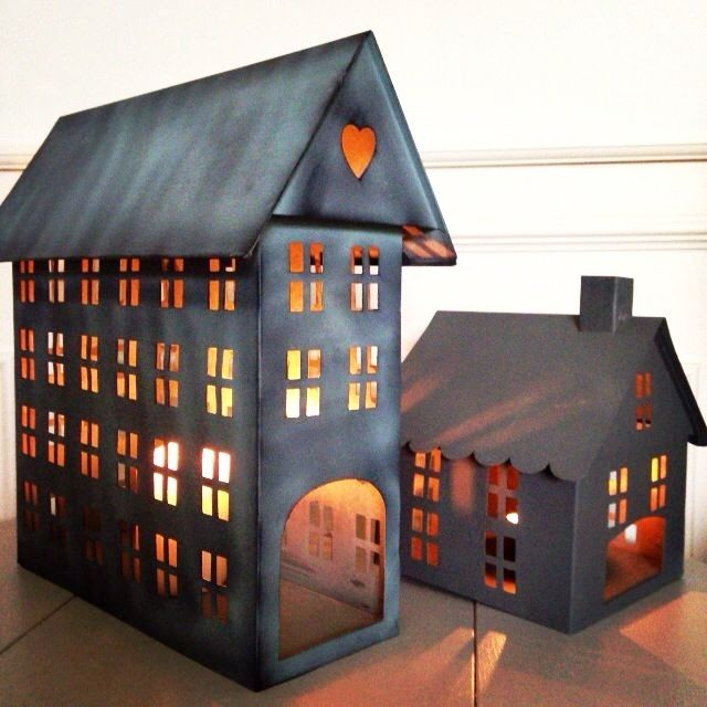 Our popular zinc tealight houses are back. Create your own little village for Christmas. Although we like to keep our houses out all year for cosy evenings, they are too beautiful to put away!We have 3 styles available:Tall rectangle grey house - 33cm Height 32cm length 10cm widthMedium square grey house - 20cm Height 18cm LengthMedium square white house