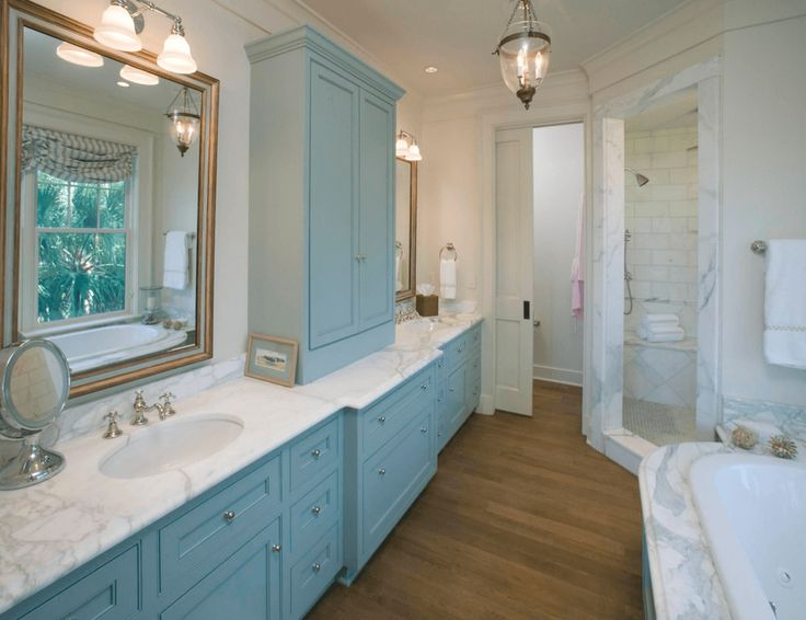 Traditional Blue Bathroom A painted cabinet makes a statement in traditional bathrooms.