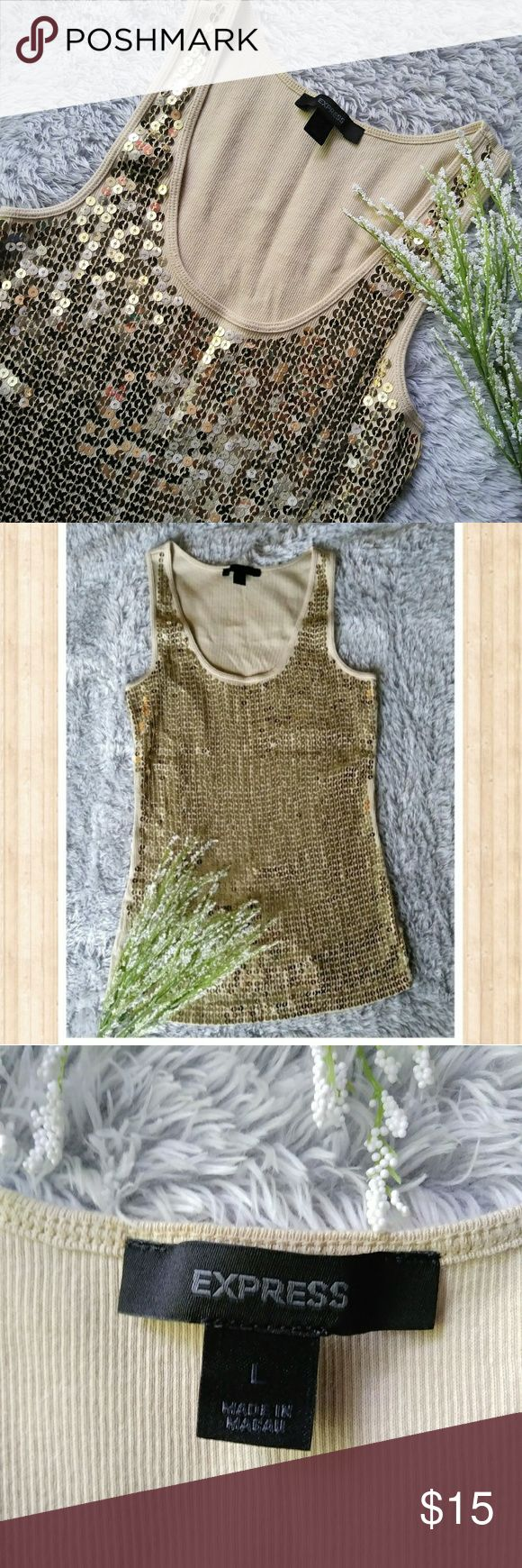 Express Gold Sequin Tank Top Size Large Fabulous gold sequin top for a night out. Size large but could also be warn as a medium. Pre-owned in perfect condition. 100% prima cotton. Express Tops Tank Tops