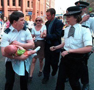 Mother Lisa Hughes reaching for baby Sam, being held by a security guard after an IRA bomb went off at the Arndale Centre in Manchester in June 1996