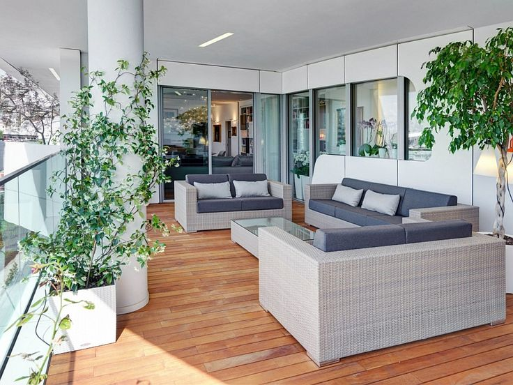 Apartments:Fascinating Patio Of Italian Apartment In City Life Milan With Lounge Chairs Also Plants In Pots Also Glass Doors And Windows Also Laminate Floor With Outside View Its Smart Design Apartment Modern Interior Design of Luxury Apartment in Milan To Inspire You