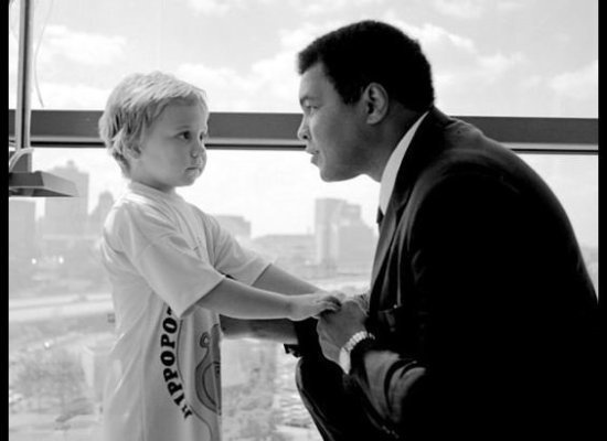 Muhammad Ali with a sick child at St. Jude's. I am not sure when this was taken... I am guessing the 80s. For all the people who say that all Muslims are terrorists, you are stupid.
