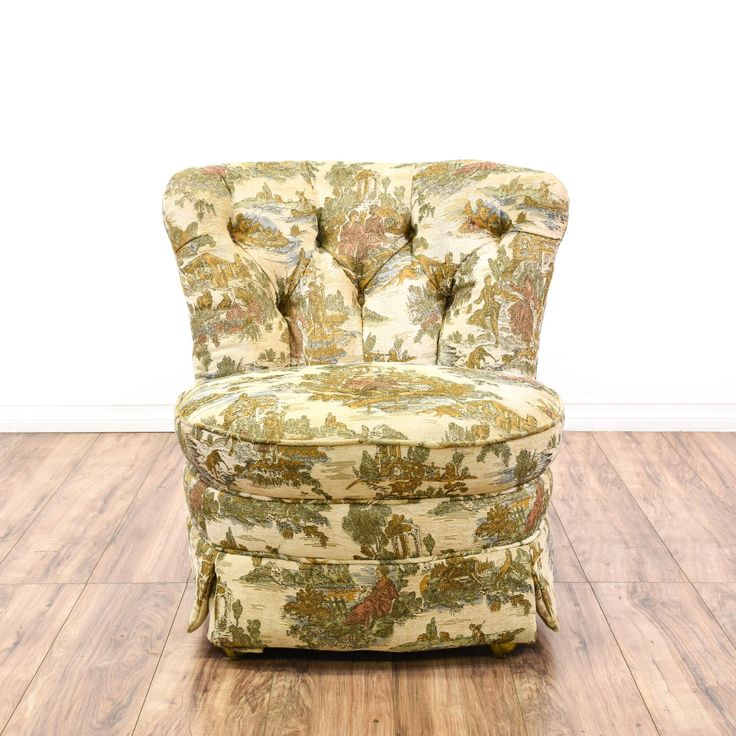 This Asian inspired chair is upholstered in a durable off white cream finish with warm gold, sage green and light pink accents. This accent chair has a curved tufted back, a rolling wheel base and chinoiserie floral scene depictions. Perfect for a sitting room! #asian #chairs #accentchair #sandiegovintage #vintagefurniture