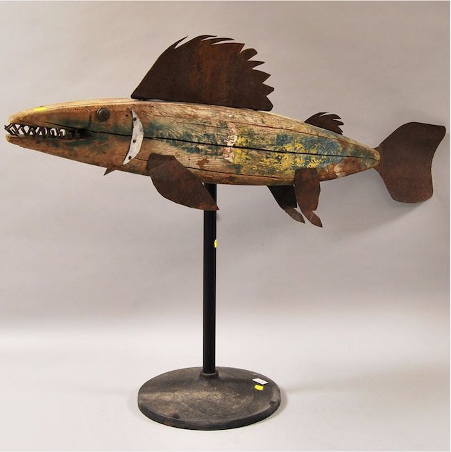 Painted wood and sheet iron codfish weather vane on metal stand. Image courtesy of Skinner Inc. and LiveAuctioneers