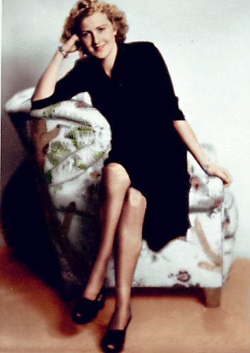 """An excellent (albeit colorized) portrait of Eva Braun taken by Ernst Baumann in Munich in 1941. Hitler, in a rare fit of open jealousy, decided that Baumann had gotten """"too close"""" to Eva and when he saw his photographs of his mistress, promptly sent..."""