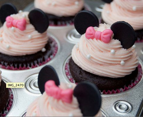 """Minnie-fy"" ordinary cupcakes with some spectacular Minnie Mouse fondant cupcake toppers ($15 for 12) for the ultimate Minnie birthday treat!"
