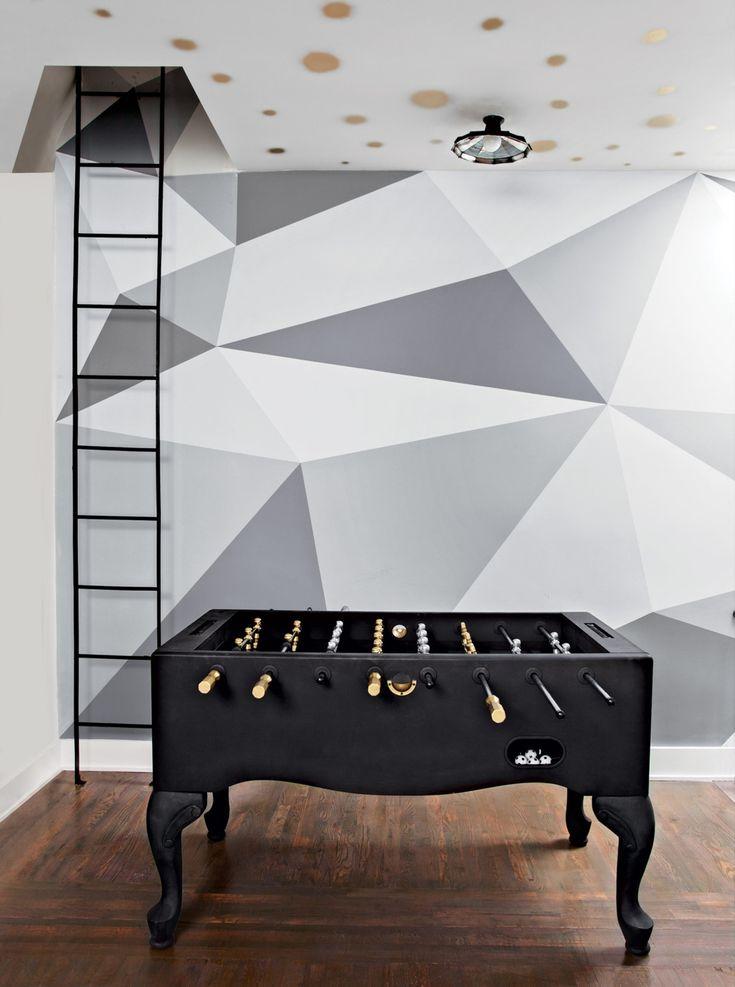 The Foosball table was painted black. The geometric mural is by Aurora Hales. Photo: Floto + Warner
