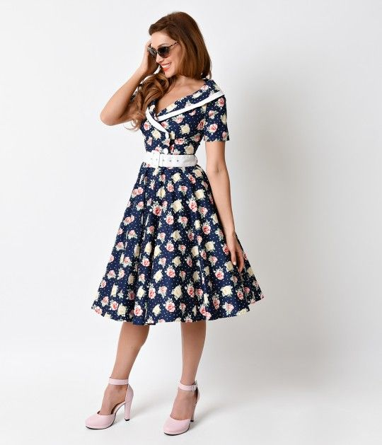 It's a match! A radiant retro dress style steeped in patterned perfection, The Emma 1950s Dress from Hell Bunny is a lightweight navy cotton frock with stunning rose blooms and polka dots throughout. This midcentury design features short sleeves and a but