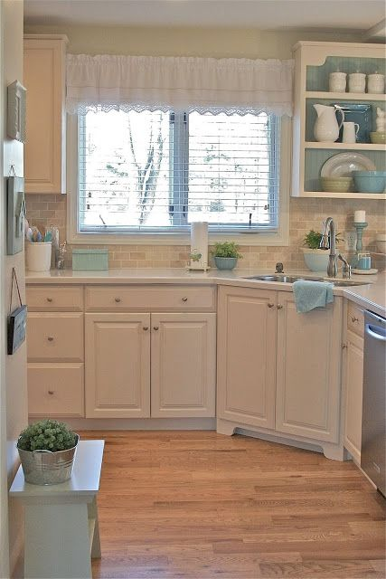 A Pocketful of Blue ~ Cottage Coastal Style Kitchen.  Painted white kitchen cabinets and hardwood floors create a pretty cottage kitchen.