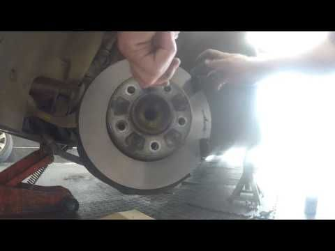 Fitting front brake pads and sensor to a Bmw 325I E60, basic tools