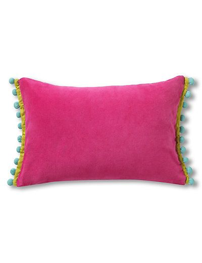 I love this for in the middle of my plain sofa. Pom Poms are the bizz this year.  Boho Pom Pom Cushion | M&S
