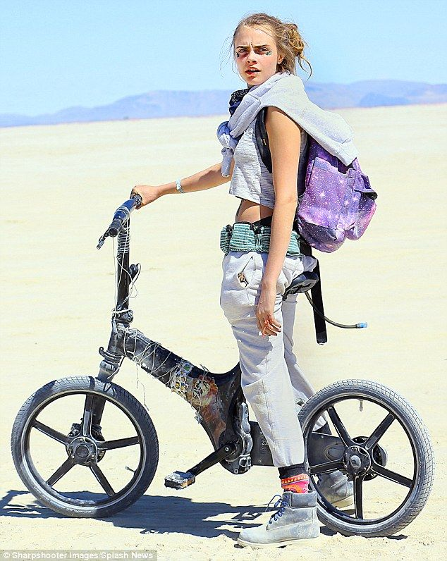 On your bike: Cara Delevingne unveiled her inner tomboy as she made an appearance at Burning Man Festival in Black Rock City, Nevada, at the weekend
