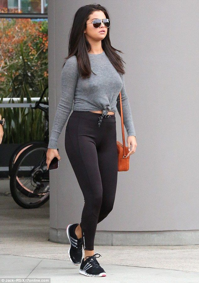 Working on her fitness: Selena Gomez looked stunning as she showed off her curves in a fitted ensemble while heading to the gym in West Hollywood on Thursday