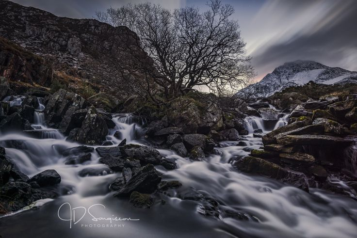 https://flic.kr/p/Ronr5s | Afon Ogwen Falls | The Afon Ogwen (Welsh, meaning River Ogwen in English) is a river in north-west Wales draining from some of the greatest peaks in Snowdonia before discharging to the sea on the eastern side of Bangor, Gwynedd. The Ogwen emerging at the western end of Llyn Ogwen immediately descends cataracts and waterfalls, known as Ogwen Falls in English and Rhaeadr Ogwen in Welsh, before continuing in a north-north-westerly direction down the glaciated Nant…