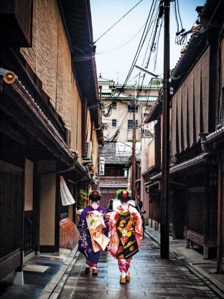 Kyoto's streets are hallway-narrow; at night, the tiny houses glow like lanterns.