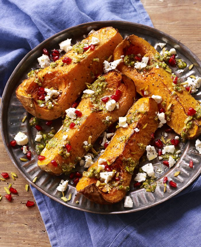 Jazz up your roasted butternut squash with pistachio pesto, pomegranate and feta.