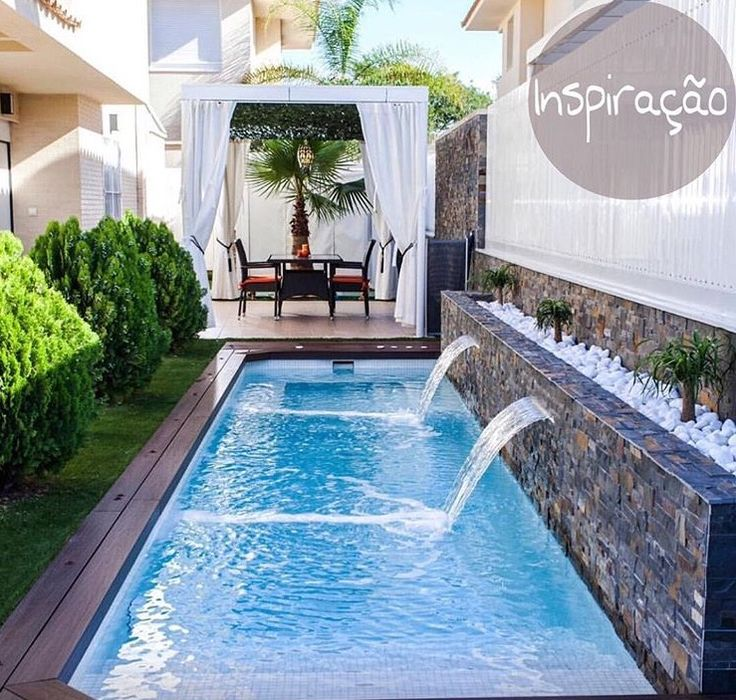 [I like the way the curtains not only mark off the patio as a special place, but also add softness and a good vertical accent to the hard edges of the pool area.]
