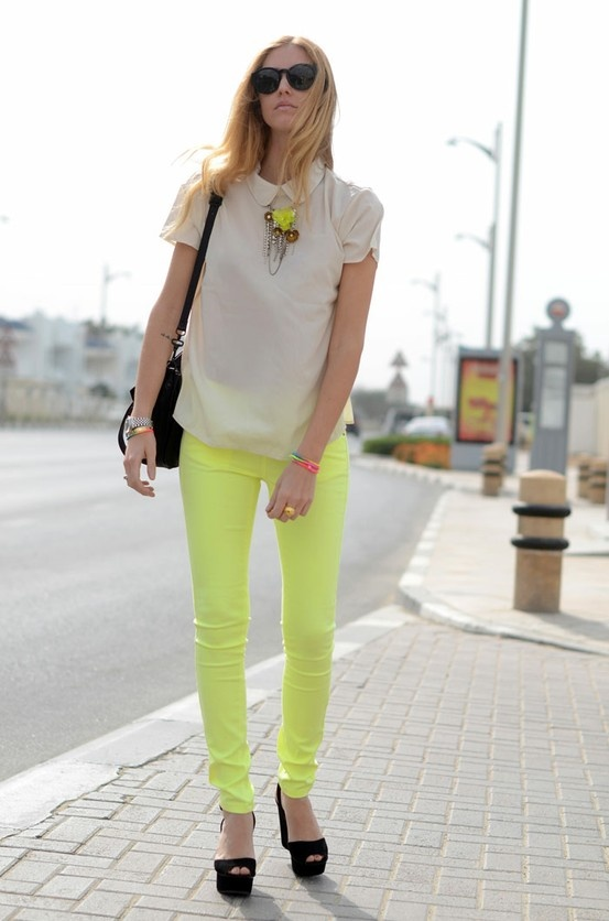 neon jeans and pretty blouse. I could do without those shoes.