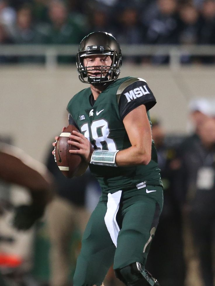 Michigan State quarterback Connor Cook passes against