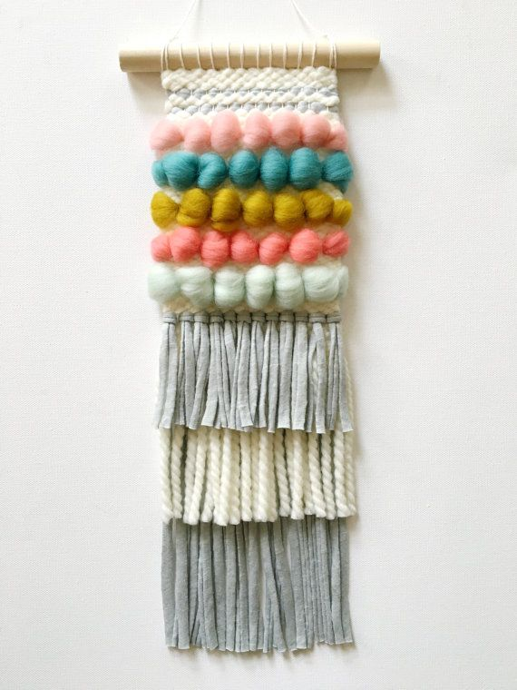 Handwoven one-of-a-kind wall hanging. Created with care and patience on a…