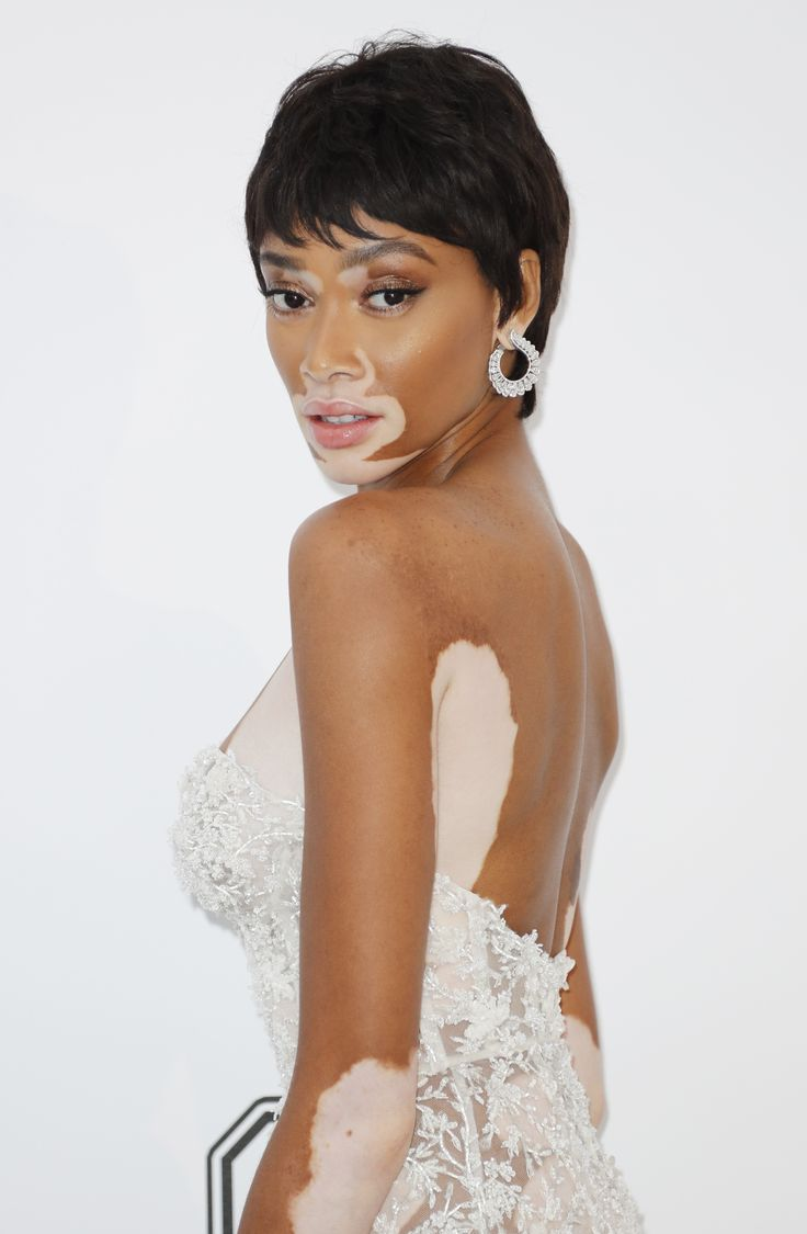 Winnie Harlow went pixie crop with Chopard Precious collection diamond earrings in 18 carat white gold and a beaded white lace and mesh dress to the floor. At the amFAR Gala. For glamour celebrity fashion Cannes Film Festival red carpet jewellery spotting travel here: http://www.thejewelleryeditor.com/jewellery/top-5/cannes-film-festival-amfar-gala-2017-red-carpet-jewellery/ #jewelry