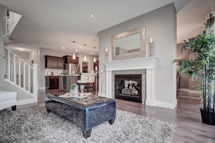 Cozy living room with a beautiful two-way #fireplace http://blog.yourpacesetter.com/blog/bid/335496/New-Show-Home-The-Kristana-in-Crystallina