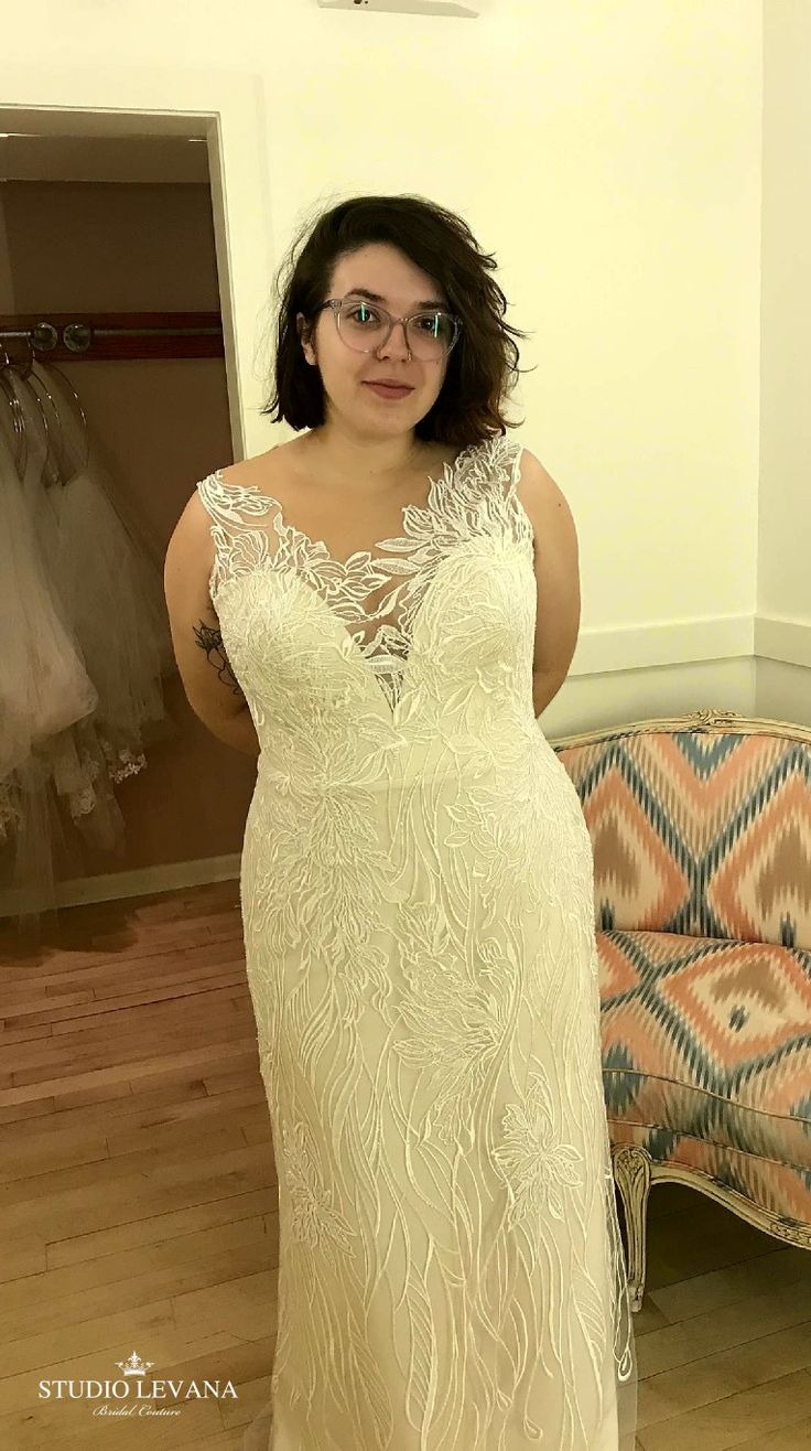 Curvy girl in a fitted lace wedding gown from Studio