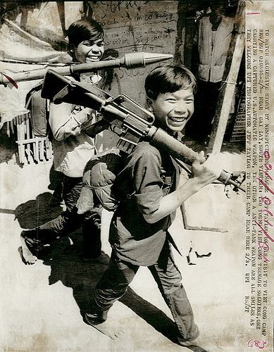 Teenage Viet Cong soldiers near Cai Lay, one carrying a captured U.S. automatic weapon. 1973