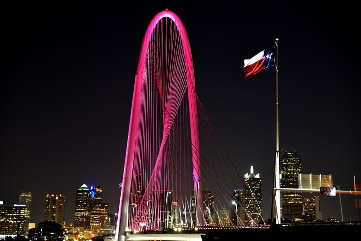 The Margaret Hunt Hill Bridge in Dallas glows pink in honor of Mary Kay Inc.'s 50th anniversary celebration. The bridge will be illuminated in the special pink hue from July 21 - Aug. 7 in honor of Mary Kay's annual convention, known as Seminar, which brings 50,000 attendees to the Kay Bailey Hutchison Convention Center and delivers an economic impact of more than $49 million to the city of Dallas. Photo courtesy of Mary Kay Inc.