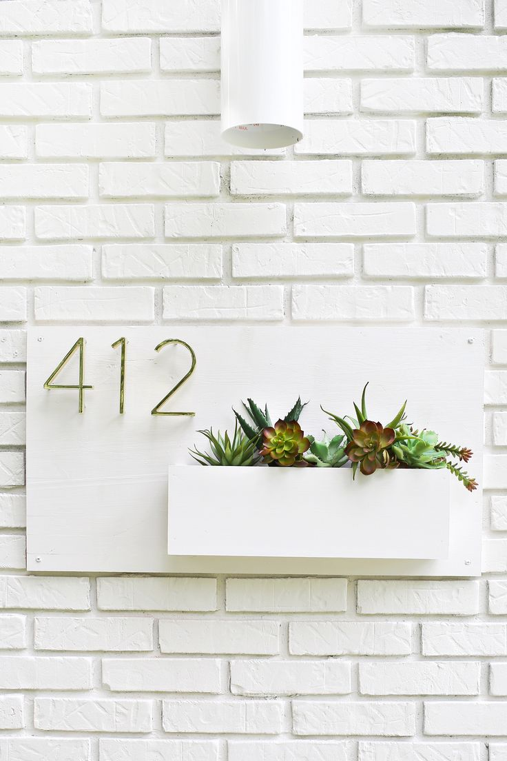 I like this style of house numbers, and the planter idea is cute. I'd prefer the numbers directly over the planter...?
