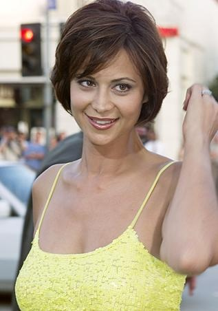 Catherine bell in a spaghetti strap yellow dress