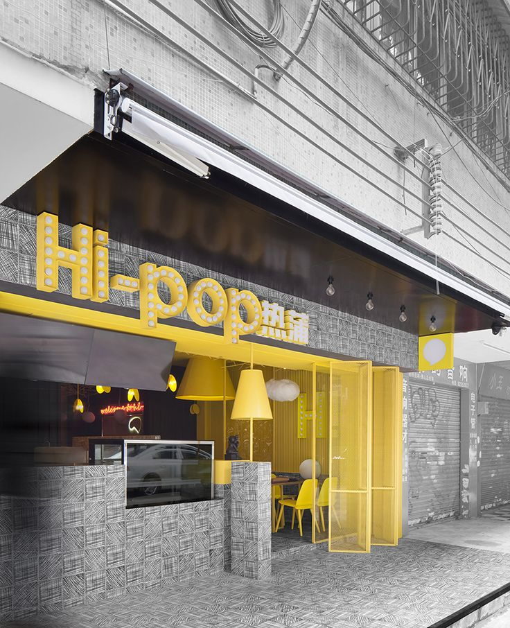 the eatery is defined by a palette of bright yellow and black tile, a choice the studio hopes will appeal to a more youthful frame of mind.
