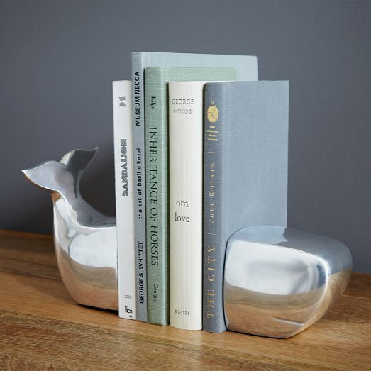 Wild side. In the shape of a whale split in two, these hefty bookends keep your bookshelves in playful order.