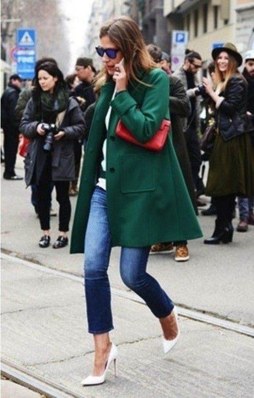 Go for a dark green coat and navy jeans and you'll look like a total babe. Add a little glam to your getup and throw in a pair of white leather pumps.  Shop this look for $83:  http://lookastic.com/women/looks/navy-jeans-and-dark-green-coat-and-red-clutch-and-white-pumps/14  — Navy Jeans  — Dark Green Coat  — Red Leather Clutch  — White Leather Pumps