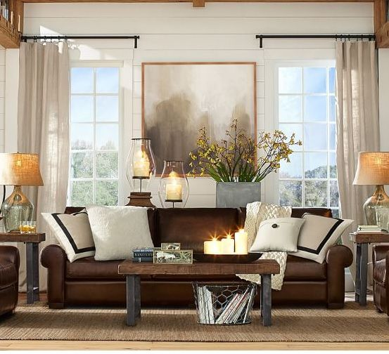 Pottery Barn styling of brown leather sofa. Brown lounge, white cushions, natural materials, black bordered cushions